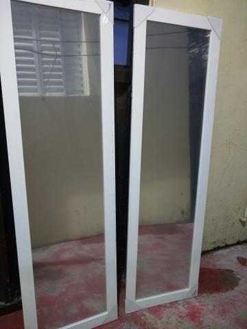 Espelho marca Leão grande cada um à vista r$ 100