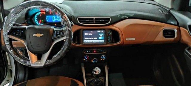 Chevrolet Onix Active 1.4 2018 60mil km  - Foto 6
