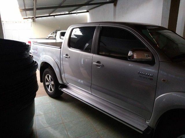 Toyota Hilux completa Crv top