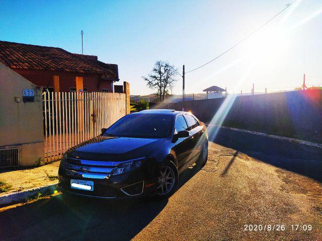Ford Fusion V6 AWD com teto central REVISADO