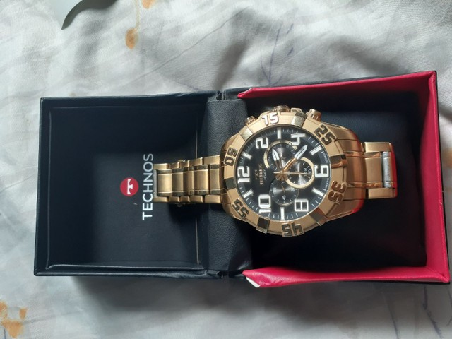 Vendo ou troco relógio TECHNOS dourado.  - Foto 6