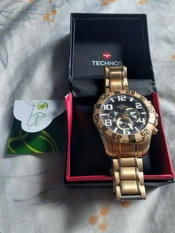 Vendo ou troco relógio TECHNOS dourado.
