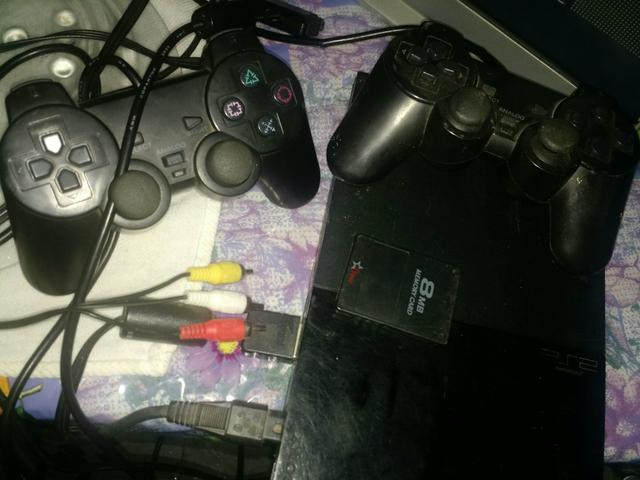 Playstation2 + dois controle + memory card+ cabos