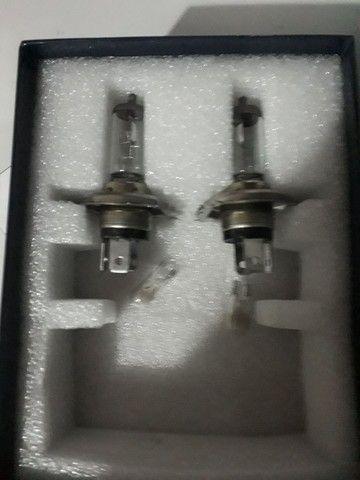 Vendo lampada h4 acompanha duas de pingo - Foto 2