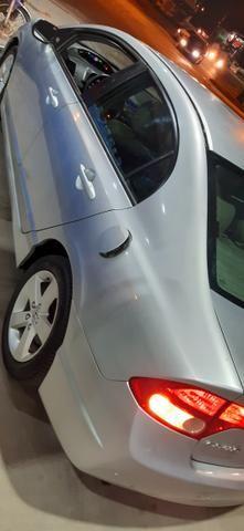 Vendo ou troco .carro impecável único dono .Tudo em dia.aberto a negócio - Foto 4