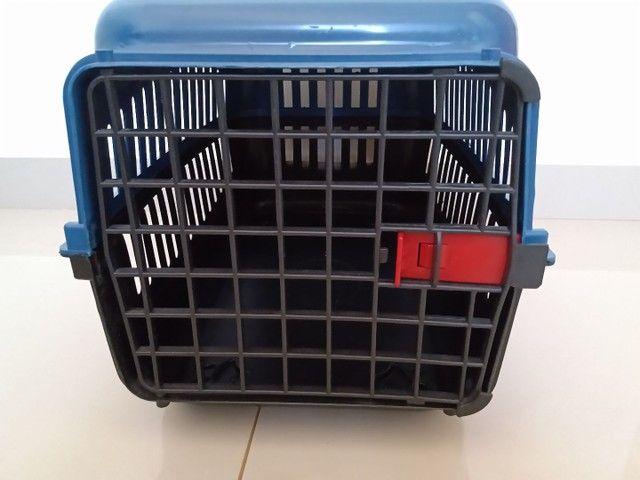 Caixa transporte pra cachorro.