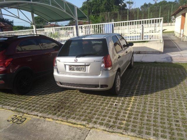 Vende-se palio economy 2010 prata 4 portas flex - Foto 7