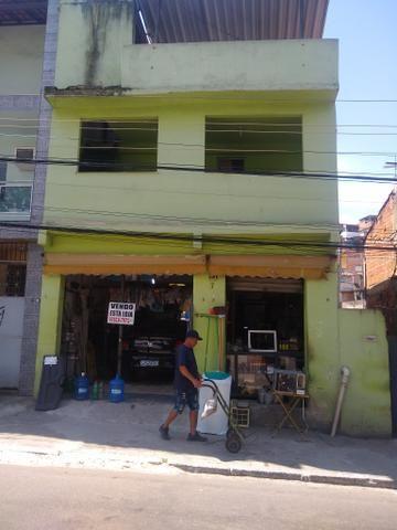 Vendo casa com loja e garagem - Foto 2