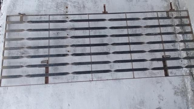 Portão de ferro 0.80 por 2.15 valor 180 tel *