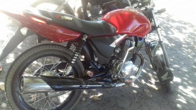 Compro repasse ou moto 2000