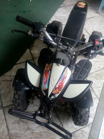 Quadriciclo infantil motorizado