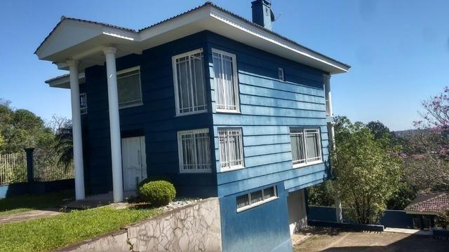 Taquara-Casa com 3 dormitórios e piscina-centro