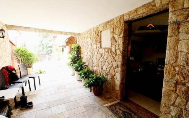 Casa térrea com 4 dormitórios para alugar, 295 m² por R$ 6.000/mês - Parque das Nações - S