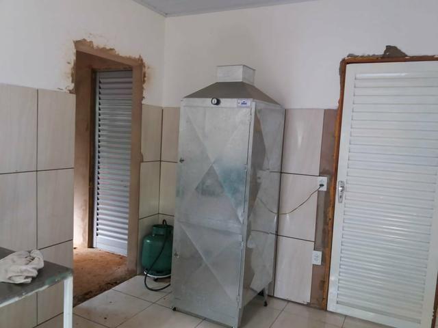 Vendo chácara de 7 hectares com 2 casas 1 cozinha caipira com fogão de lenha - Foto 14