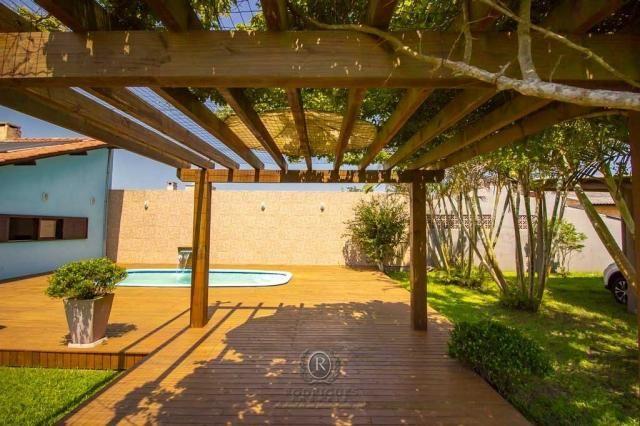 Casa com piscina 04 dormitórios Arroio do Sal RS - Foto 12