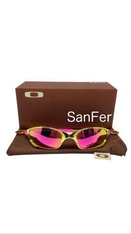 2990fa200d9b5 Oculos Oakley Juliet Doublex GOLD 24k armação de metal e lente polarizada  rosa e roxa