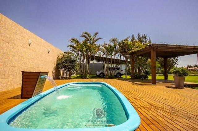 Casa com piscina 04 dormitórios Arroio do Sal RS - Foto 9