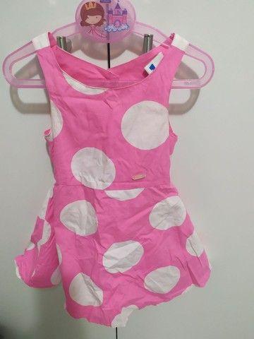 Vestido rosa com bolas branca. 2 anos.