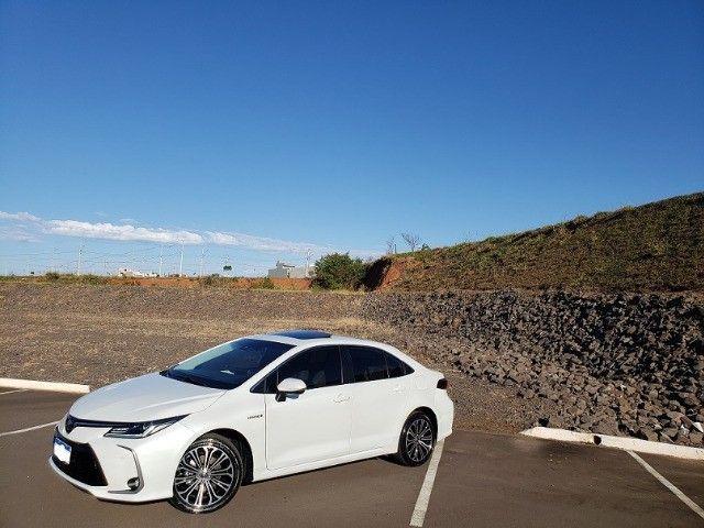 Corolla Altis Premium Hybrid 2022, 3.000km, Teto Solar, Flex e Elétrico