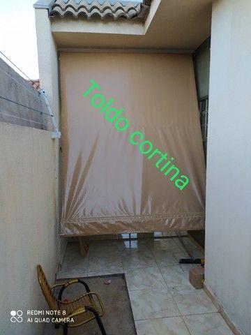 Toldo cortina de enrolar (m²)