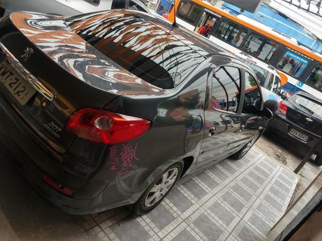 Peugeot Passion 207 Completo FLEX+GNV R$1.000,00 de entrada 48x 385,00 - Foto 6