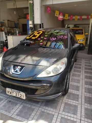 Peugeot Passion 207 Completo FLEX+GNV R$1.000,00 de entrada 48x 385,00