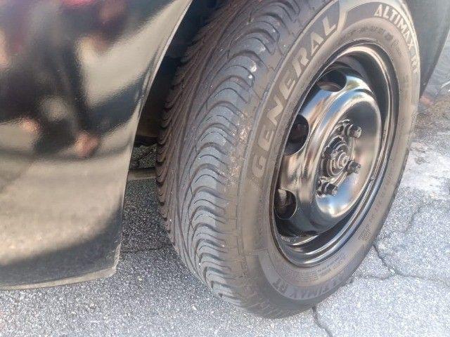 Celta 2003 com 4 pneus zeros  - Foto 10