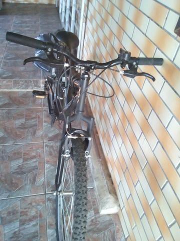 Bicicleta semi nova, com mola em excelente estado - Foto 3