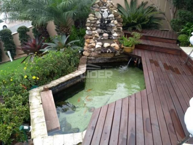 Casa de alto padrão, com jardim e piscina, no Bairro Estrada das Areias - Foto 8