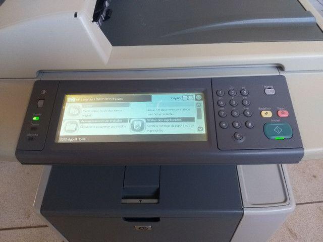 Impressora e copiadora HP p3027 bem conservada com toner novo