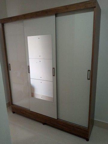 Guarda roupa espelho porta correr é gavetas
