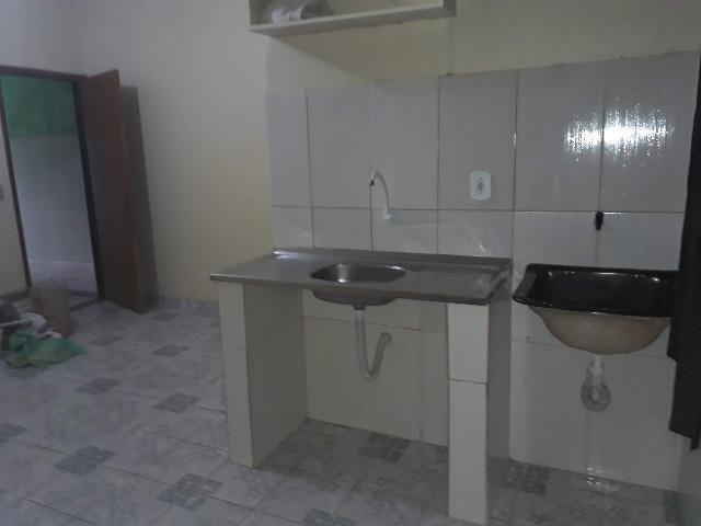 QNL Sobrado 4 kits mais casa de fundo renda de R$2.400 só 230mil aceita carro - Foto 8