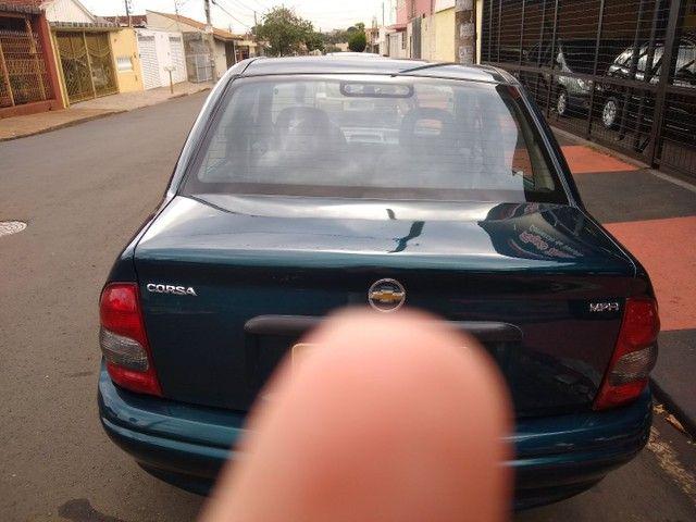 Corsa 99 direção vidro e trava top - Foto 4