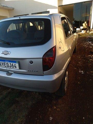 Vendo celta  4p LT ar  diressao  erbag duplo freios ABS e vidro elétrico  - Foto 4