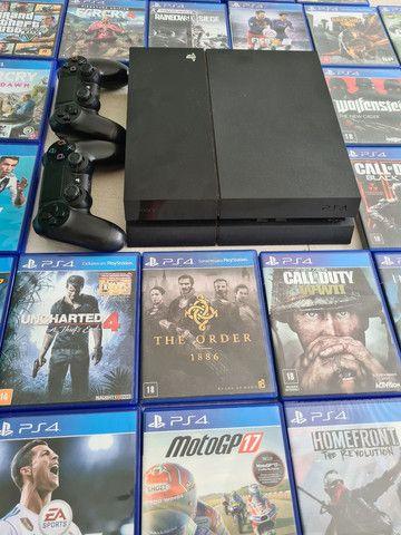 Vendo PS4 com 2 controles e 34 jogos originais - Foto 6