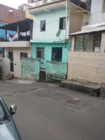 Casa no térreo em frente de rua *