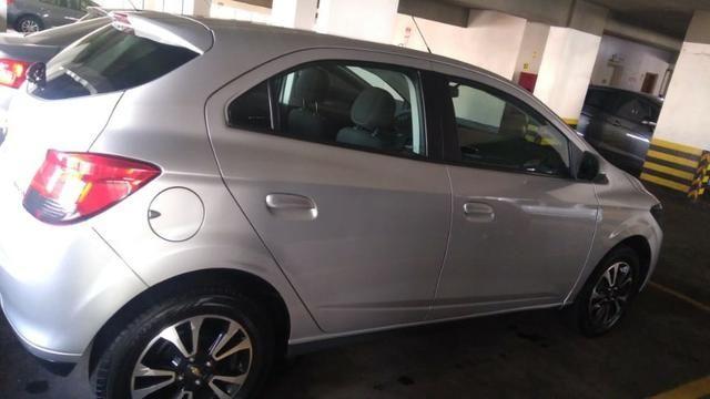 Chevrolet onix em perfeito estado, 4 pneus novos, único dono, nunca foi batido pago - Foto 3