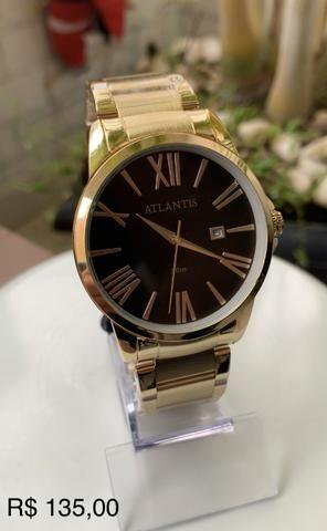 Relógio Atlantis dourado. Ótima qualidade. Aceitamos cartões !