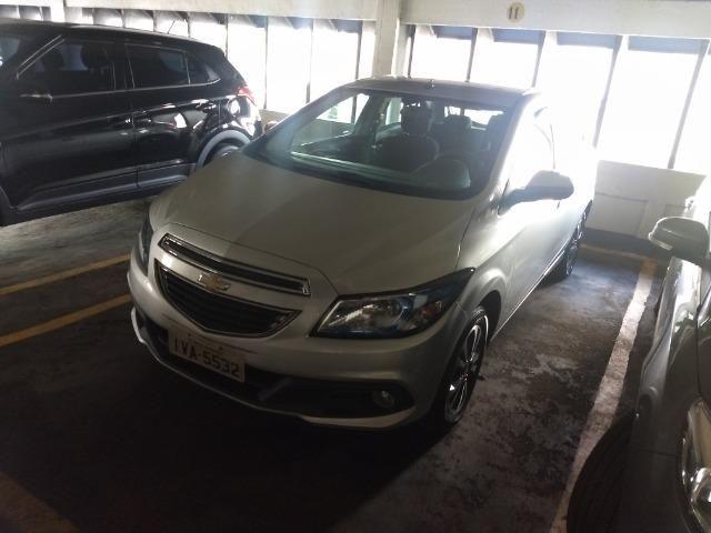Chevrolet onix em perfeito estado, 4 pneus novos, único dono, nunca foi batido pago - Foto 4