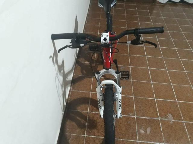 Bicicleta Caloi wild XS Aro 20 7 Marchas - Foto 2