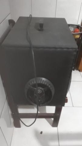 Caixa de som toca na luz 400 reais