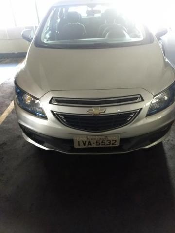 Chevrolet onix em perfeito estado, 4 pneus novos, único dono, nunca foi batido pago - Foto 5