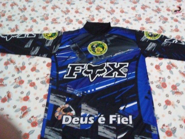 Vendo farda de moto táxi  nuca usada 30 reais  - Foto 4