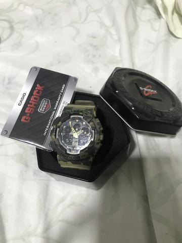 02a33de6781 Relógio Gshock GA-100 camuflado - Bijouterias
