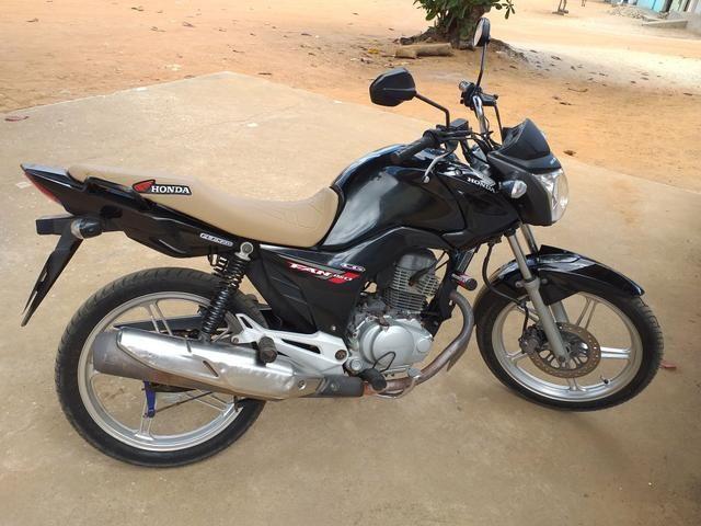 Vendo ou troco moto todo perfeita fan 150