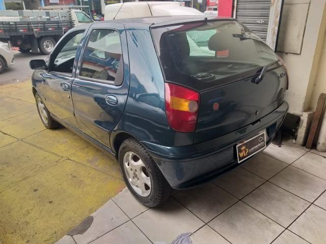 Fiat palio com direção financiamento com score baixo - Foto 12