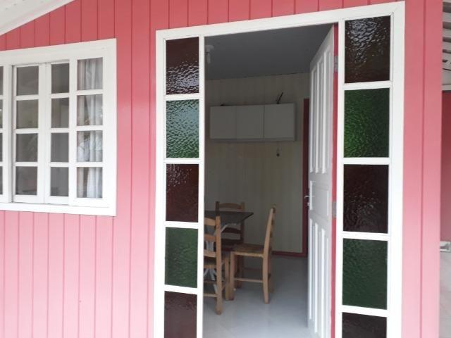 Vendo pequena casa de madeira na Pinheira - Foto 4