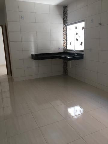 Carolina Parque Casa com varanda na frente com dois quartos sendo um suíte com ducha - Foto 10