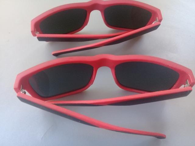 Óculos escuros vermelhos novos 20 reais cada - Foto 4