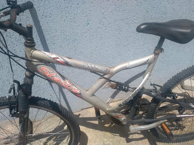 Bike suspensão no quadro e garfo - Foto 4